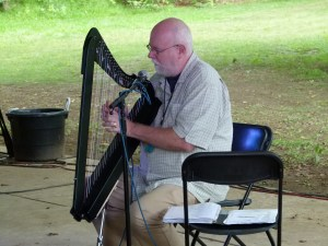 Dennis Doyle playing the harp.