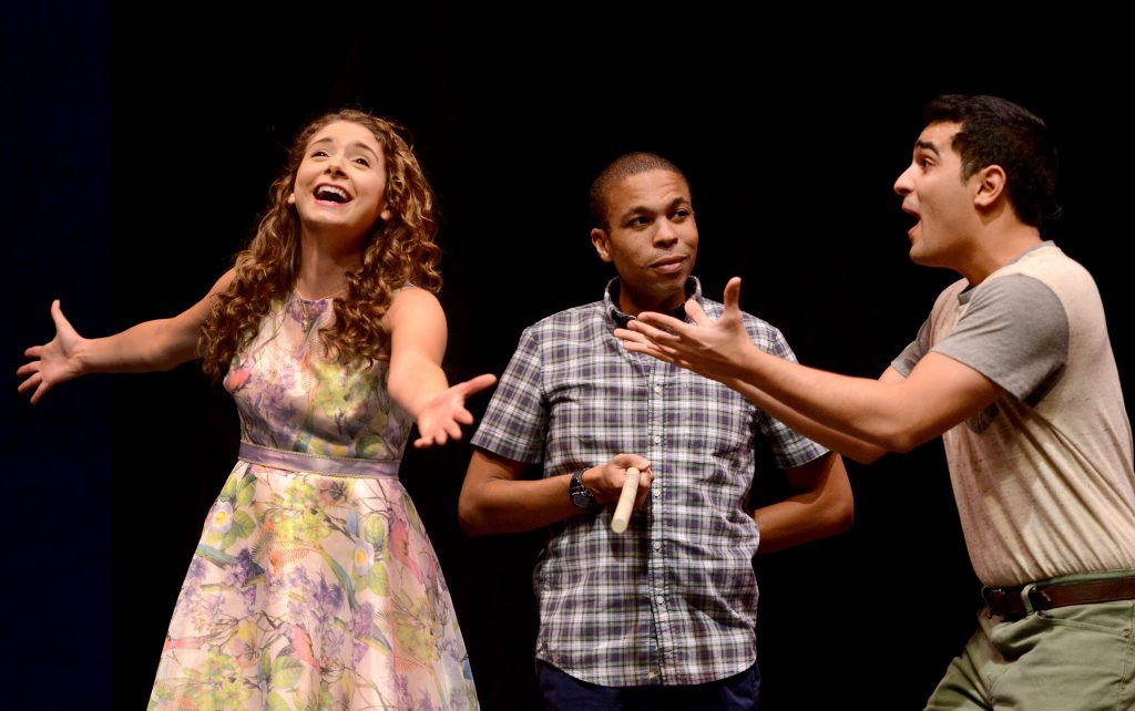 "So simple and yet so puzzling: Jason Shavers (center) says it all with a look while Mary Elizabeth Drake and Jamen Nanthakumar expound in ""The Fantasticks."""