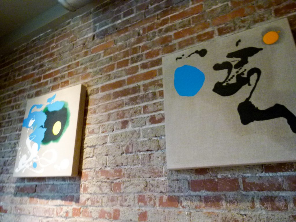 Paintings by Pittsburgh artist Mia Tarducci adorn the walls of the smaller second dining room.