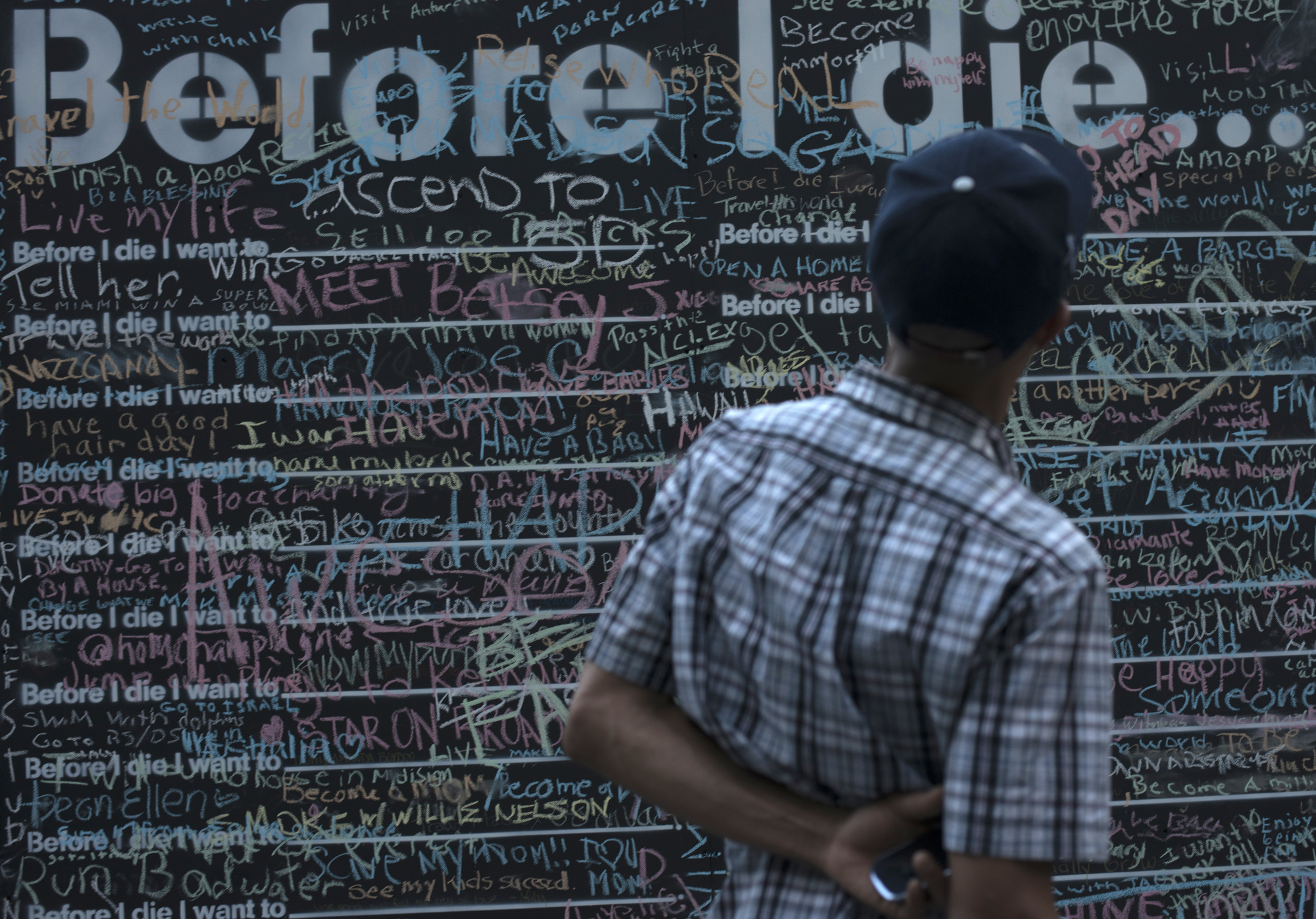 """Candy Chang's inspiring project"""" Before I Die"""" in Katz Plaza encourages viewers to reflect on their lives."""