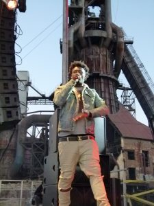 Ugly God is framed by the old (blast furnace) and new, (speakers tower) of the Carrie Furnaces site.