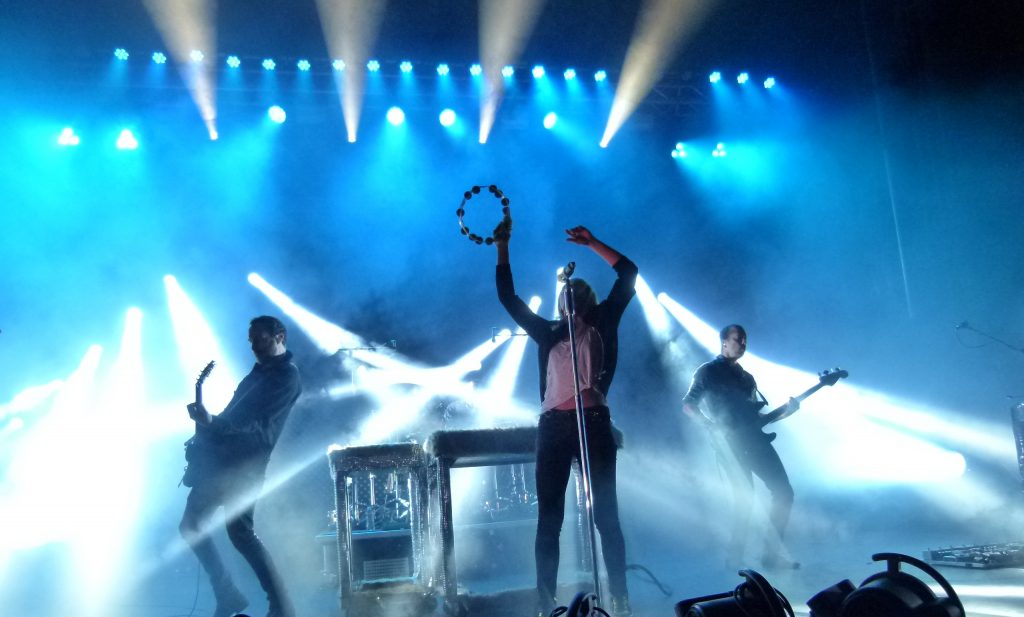 Metric looking mystical in the fog and stage lights.