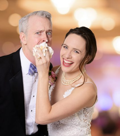 Baaad groom! Julia Geisler gives Tim McGeever a piece of her cake in CLO's 'Perfect Wedding.'