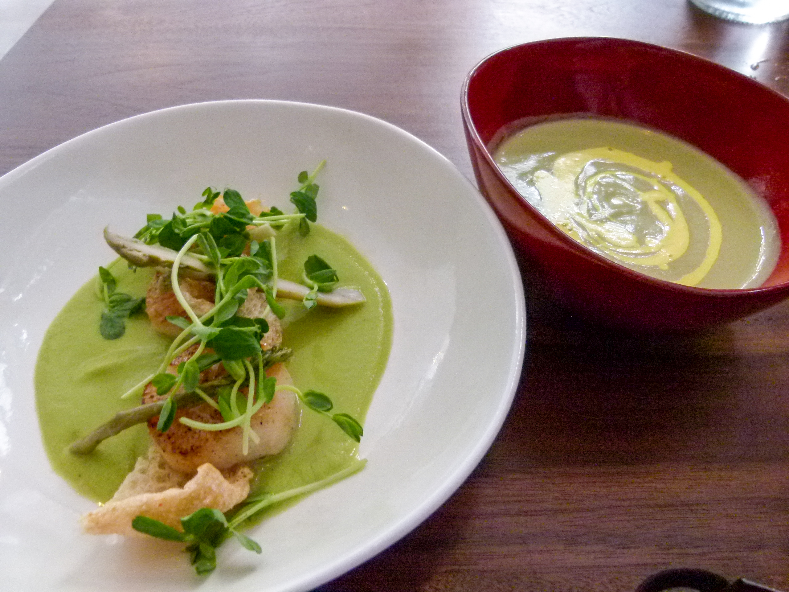 Sea scallops appetizer with ramp and cauliflower soup.