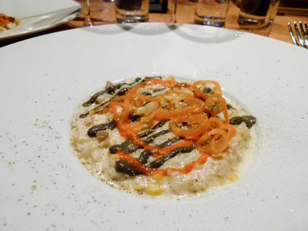 The crab appetizer with nixtamal, jalapeño,and huitlacoche served table side.