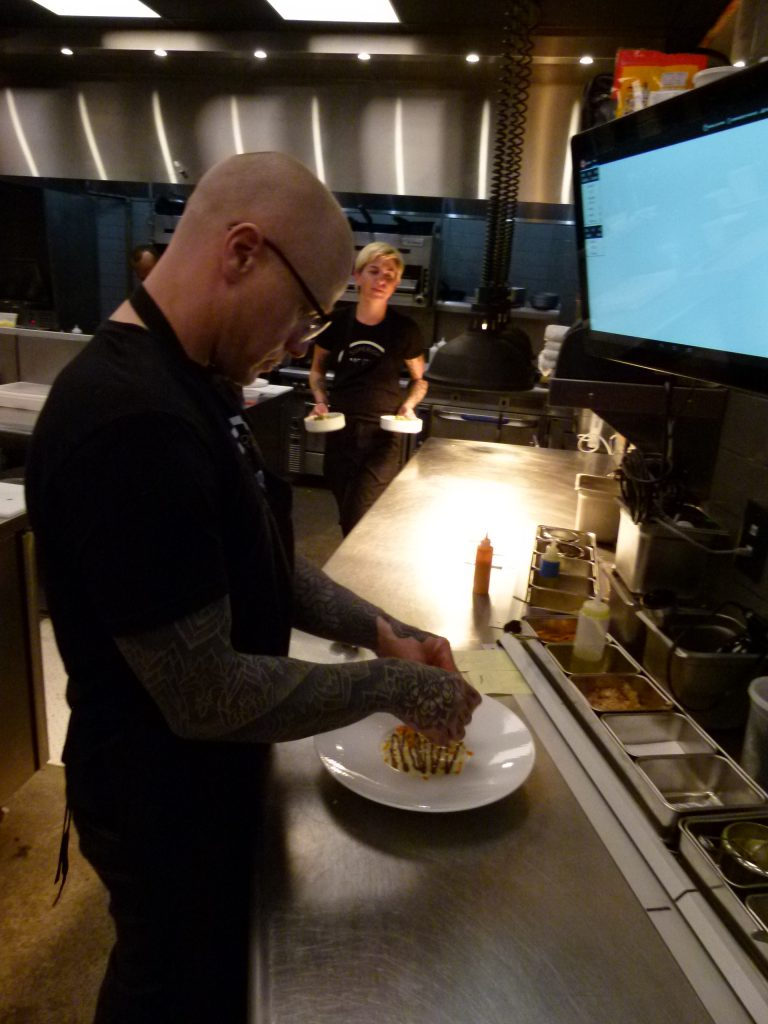 Chef Sousa puts the finishing touches on the crab appetizer.
