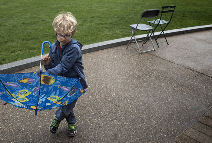 IIra Clemens, age 5, has a fish umbrella and he knows how to use it at the 422 Pop Up Dance Party on Schenley Plaza.
