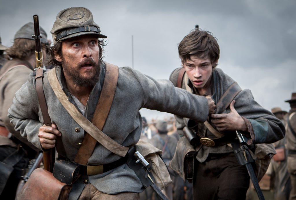 Newton Knight (Matthew McConaughey) guides Daniel (Jacob Lofland) through the ranks in 'The Free State of Jones.' photo: STX Entertainment.