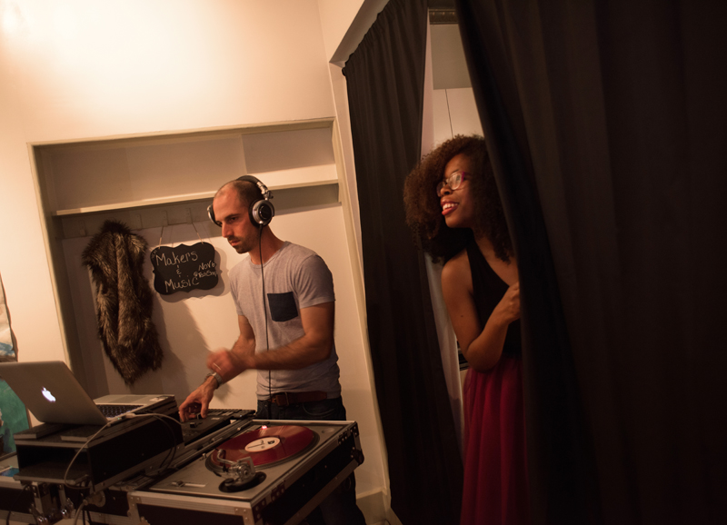 Fieldworks hosted a show called Makers & Music at Unblurred. Here, Tanisha Jackson (R) watches from backstage while DJ Illeso gets down to business.