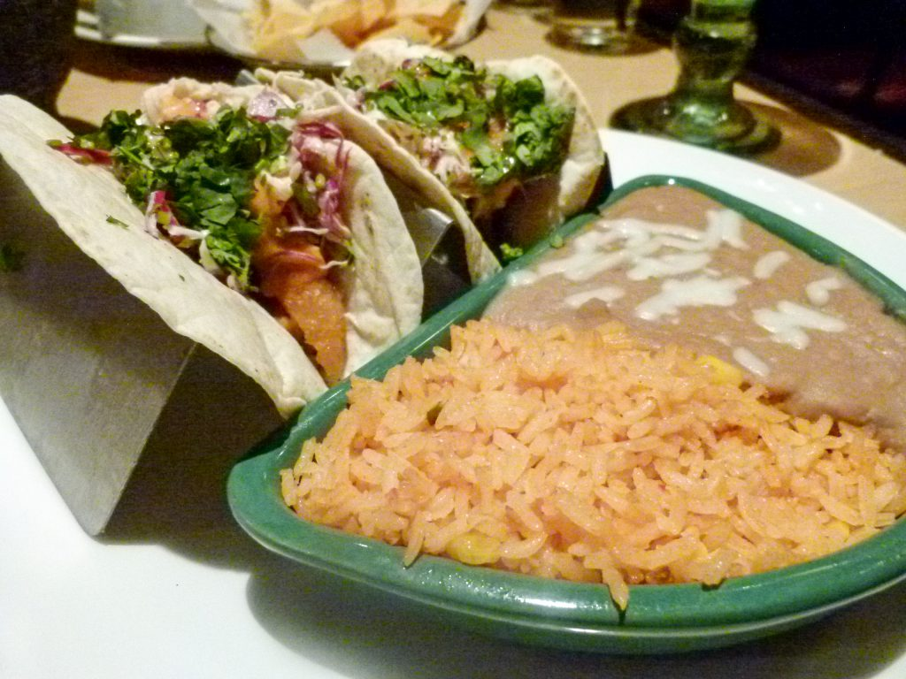 Ensenada fish tacos with refried beans and fiesta rice.