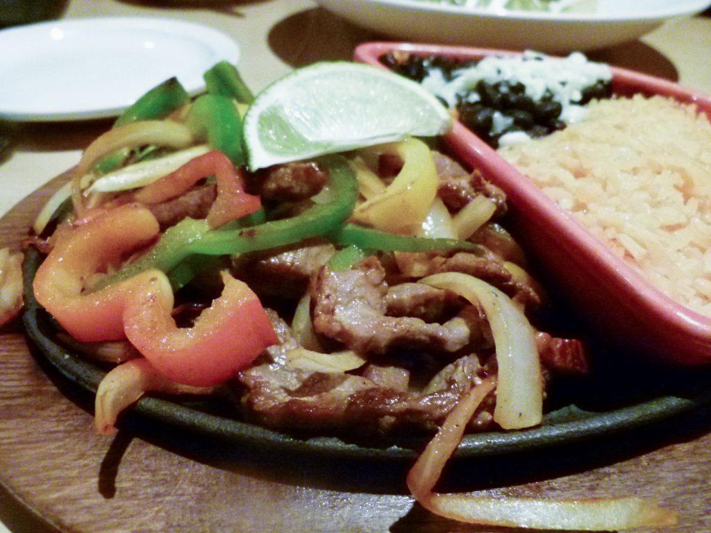 Steak fajitas with black beans and fiesta rice.