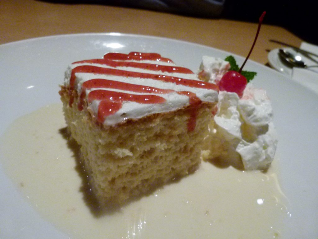 Tres leches cake soaking in a sweet three milk sauce.