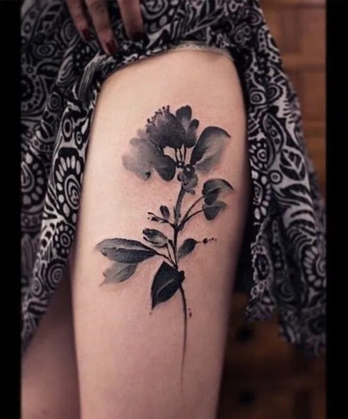 Black and White thigh flower watercolor rose tattoo