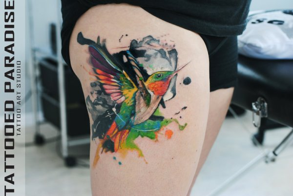 hummingbird tattoo on thigh