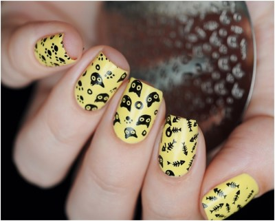 Cute yellow polish with black foot prints-skeletons of cats and fishes nail art