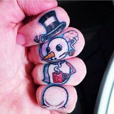snowman tattoo on fingers