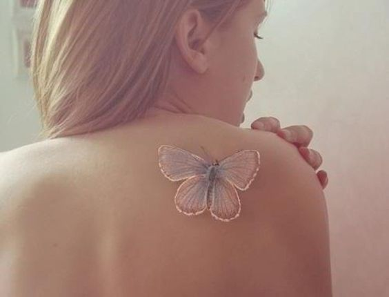white ink butterfly tattoo
