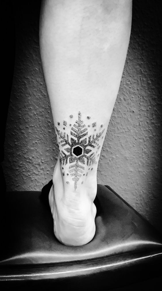 unique snowflake leg tattoo for snowy winter