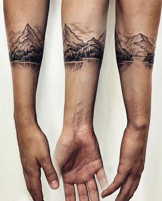 winter mountains tattoo on arm