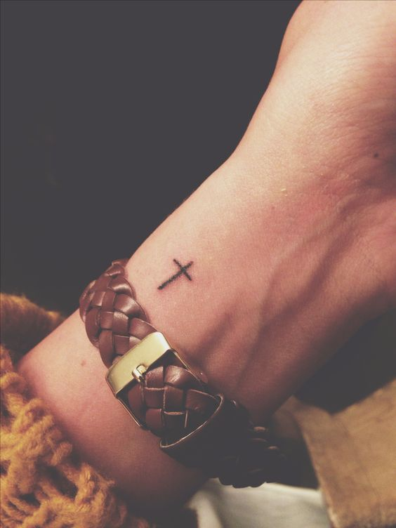 Cross Tattoo on wrist