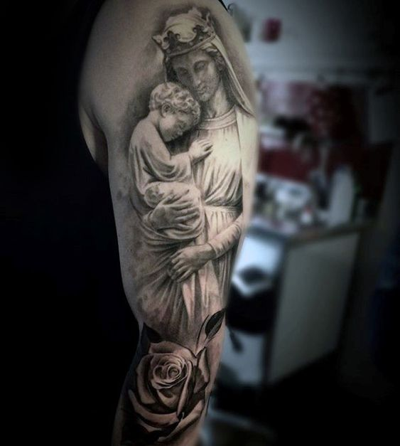 virgin mary holding jesus tattoo