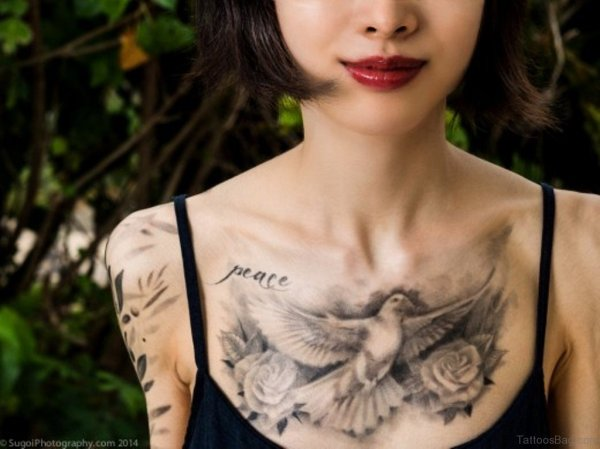 black and white dove and rose peace tattoo on chest