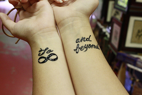 to infinity and beyond love tattoo on wrists