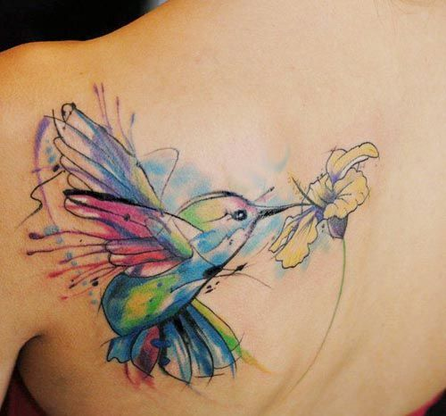 watercolor hummingbird flower tattoo on back shoulder for women