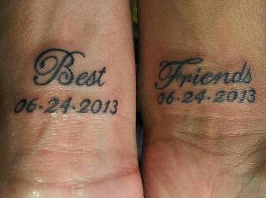 best friends text tattoo with friendship date on wrist