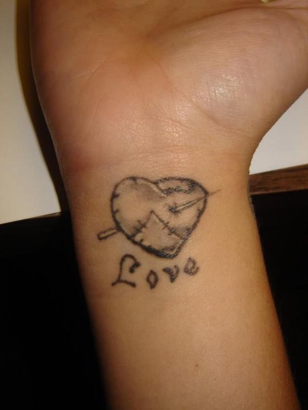 love stitched heart tattoo on wrist