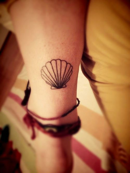 seashell tattoo ideas for summer on back ankle