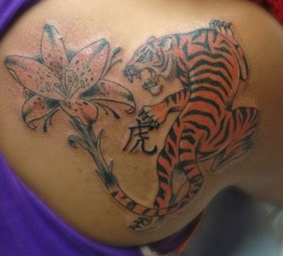 tiger lily tattoo on back shoulder with tiger
