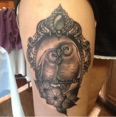 black and grey ink lovebirds frame tattoo