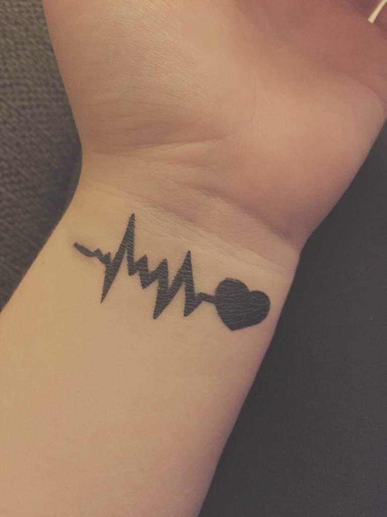 ab3c0720b black ink heart beat tattoo with heart on wrist | EntertainmentMesh