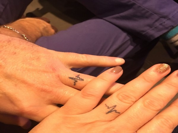 matching heartbeat tattoo on ring fingers for couples wedding