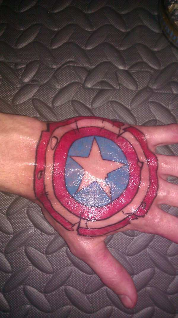 full back hand captain america shield tattoo