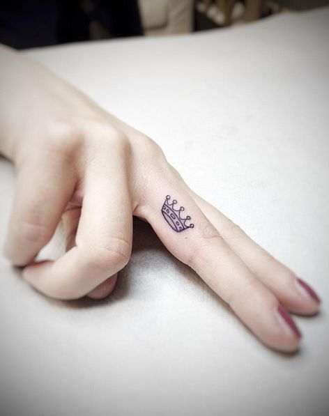 female finger tattoos