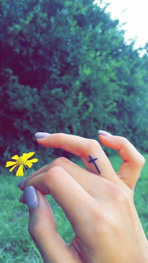 small tattoo design on finger