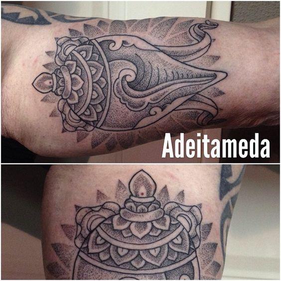 conch shell symbol tattoo