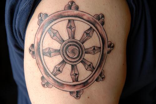 dharma wheel tattoo design on sleeve