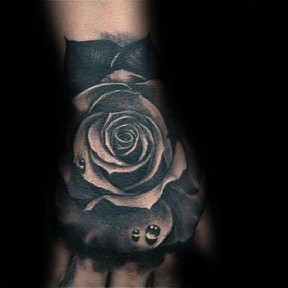 black rose flower tattoo on hand for men