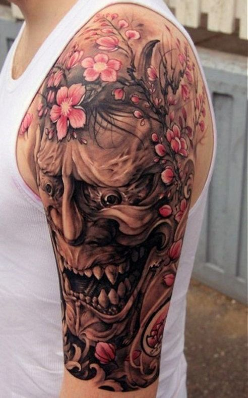 demon mask with cherry blossom fields japanese tattoo on upper sleeve men