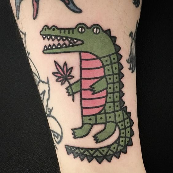 cartoon style minimal crocodile tattoo design