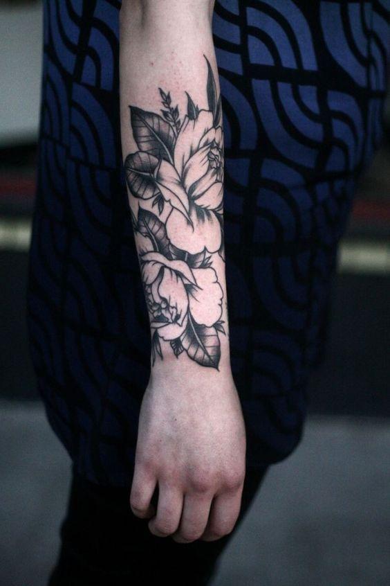 female quarter sleeve black and white flower tattoo