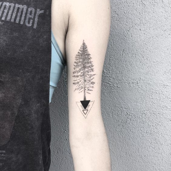 geometric pine tree tattoo design on bicep