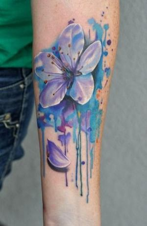 watercolor daisy flower tattoo design on forearm