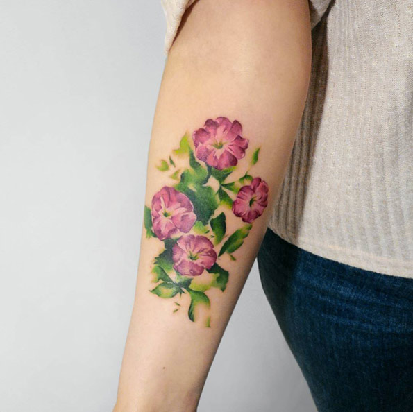 watercolor flower tattoo design on forearm for women