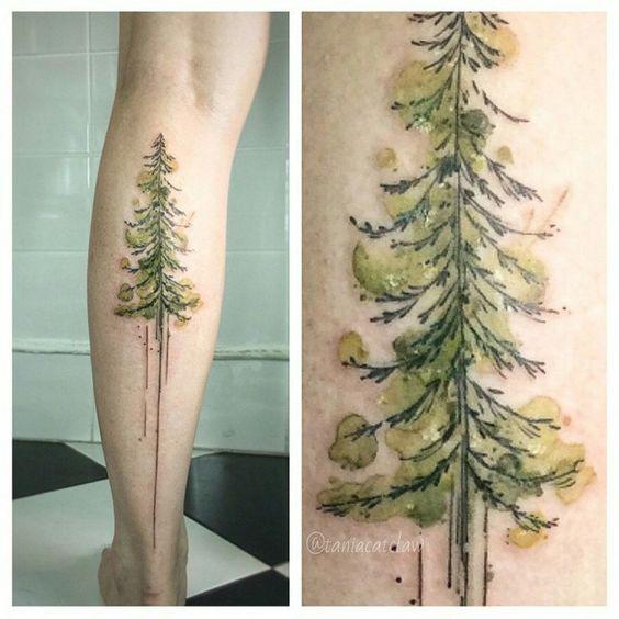 watercolor pine tree tattoo pattern on back leg