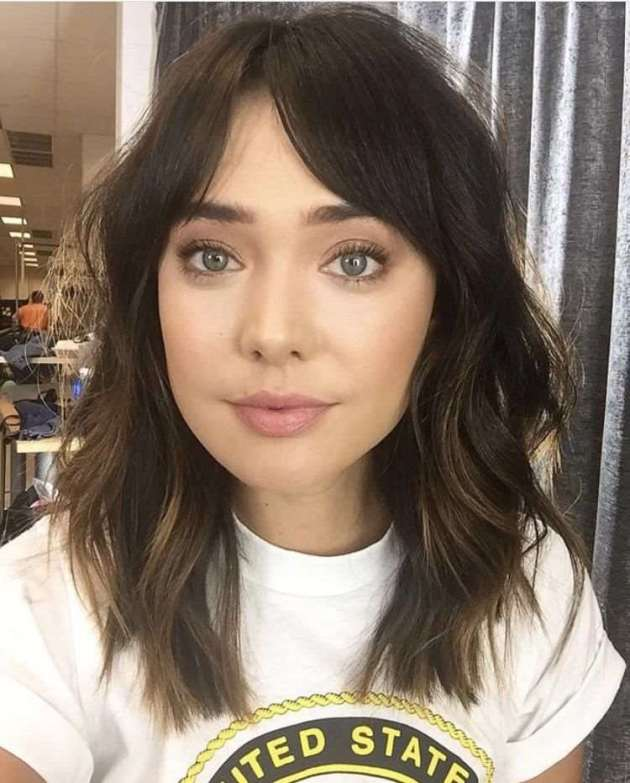 shoulder length layered side swept bangs haircut