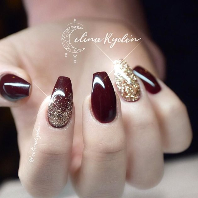 burgundy coffin nails with golden glitter and rhinestones